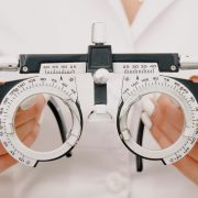 clinician holding instrument used to check eyesight